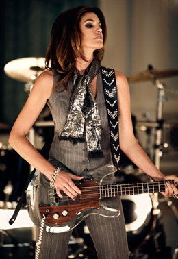 Rock-n-roll sex appeal. Cindy Crawford in waistcoat and trousers, again by Edward Sexton